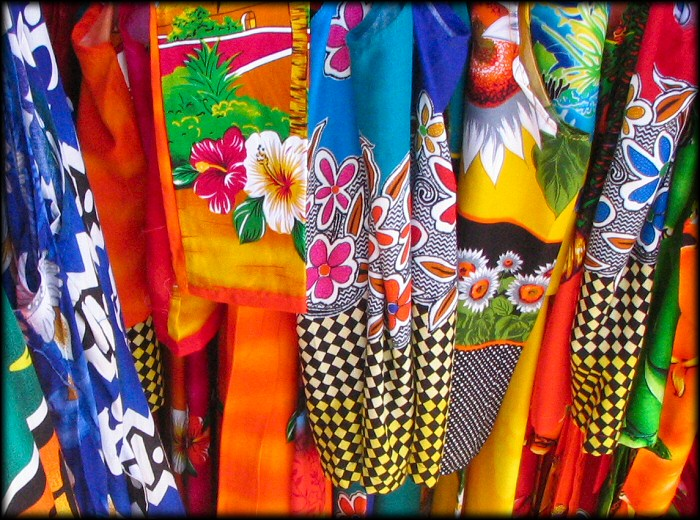 display of bightly colored dresses on main street in Bonaire